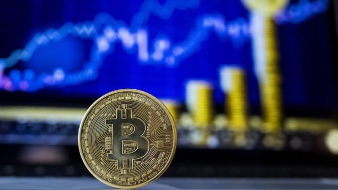 比特幣自低點回彈約16%(圖片:AFP)
