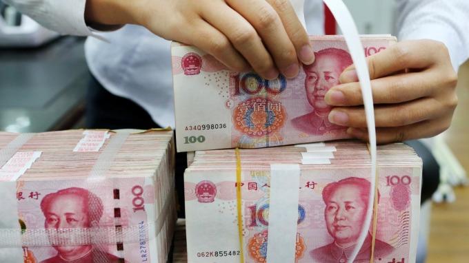 野村:25%中國商品關稅難避免 年底前人民幣恐貶破7.0關卡(圖片:AFP)