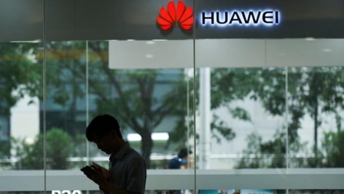 大選空窗期,華為助英四大電信商建5G(圖片:AFP)