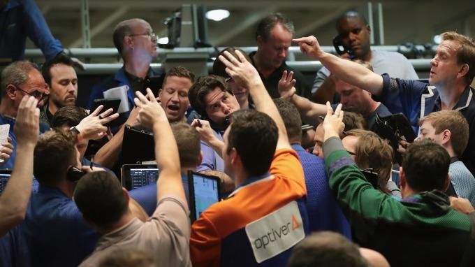 經濟趨緩中標普突破3000點 反映出投資人仍看多市場情緒(圖:AFP)