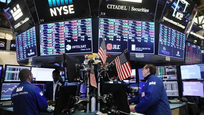 美中貿易戰休兵+全球央行偏鴿態度,激勵6月股債齊揚。(圖:AFP)