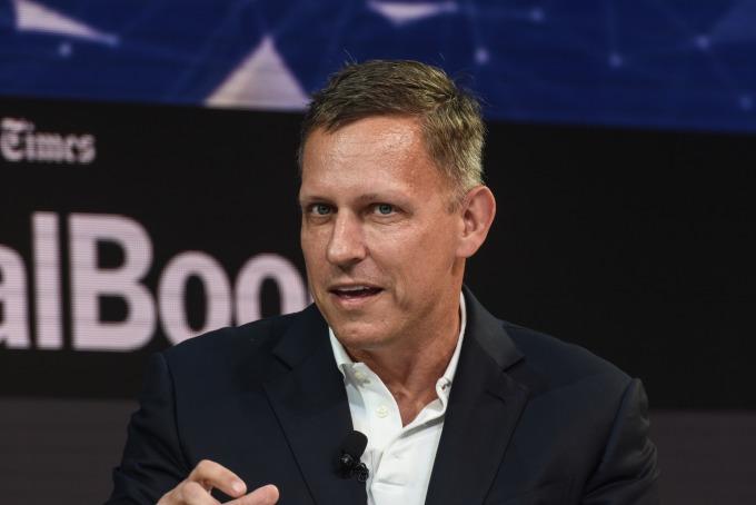 Peter Thiel 是 PayPal 共同創辦人 、臉書董座和、Palantir 投資人、對沖基金 ClariumCapital 總裁。(圖片:AFP)