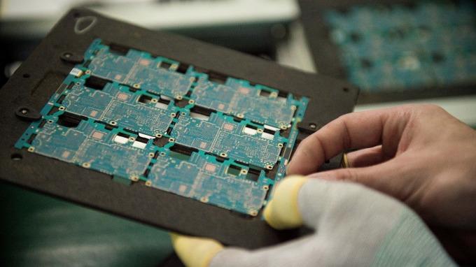 IC insights:2019年電子系統半導體含量下降至26.4%(圖片:AFP)