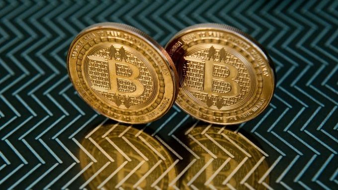 聰明錢完全看錯了「打賭區塊鏈跳過比特幣」看法遭逆轉 (圖片: AFP)
