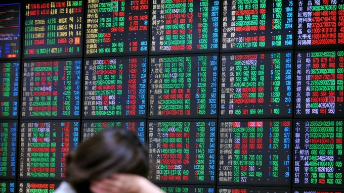 資金回流台灣,有利台股高股息高獲利成長族群突圍。(圖:AFP)
