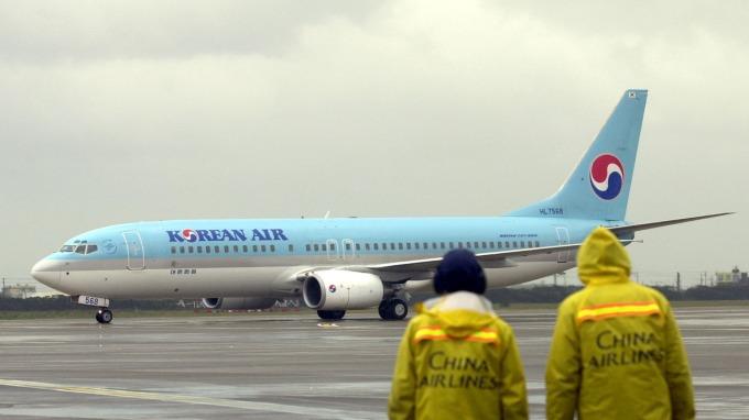 貿易緊張引發需求壓力 大韓、德威等航空削減日本航班 (圖:AFP)