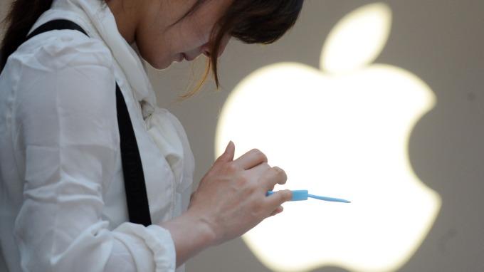 川普打出新關稅牌,蘋果與供應鏈恐難逃一劫。(圖片:AFP)