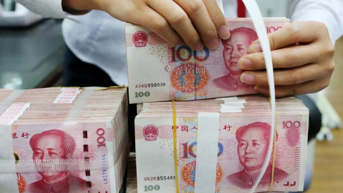 貨幣戰正式開打?人民幣破7引發聯想(圖片:AFP)