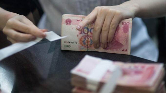 人民幣「破7」 為何引發全球股市大跌及貿易戰升級?(圖片:AFP)