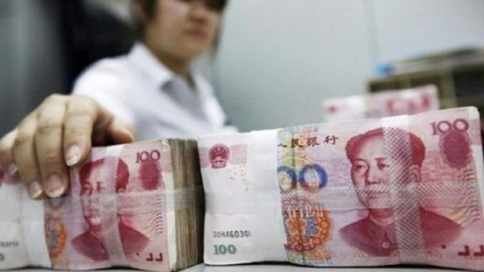 人民幣中間價再創2008年4月新低!人行8/14將發離岸央票收流動性 圖片:AFP