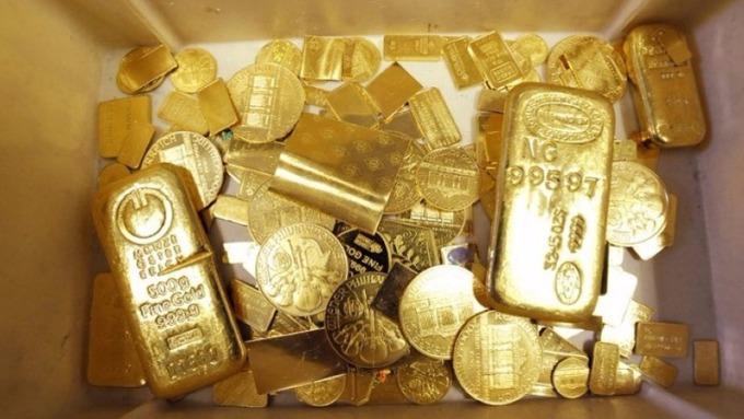 利率低就是持有黃金的機會成本 短線估回檔 但仍上看1600美元。(圖:AFP)