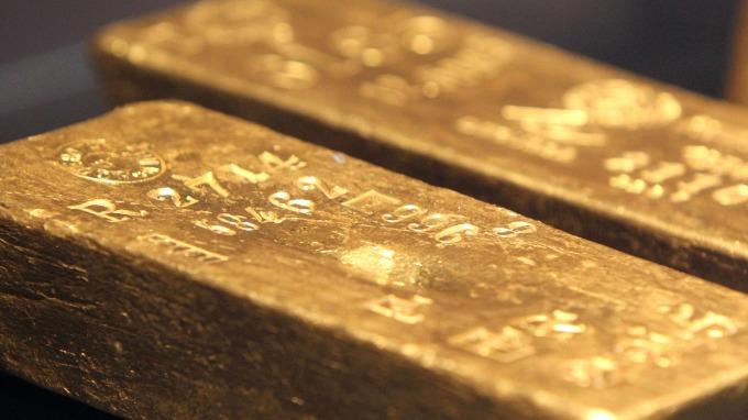 全球金融市場動盪 黃金ETF需求強勁(圖片:AFP)
