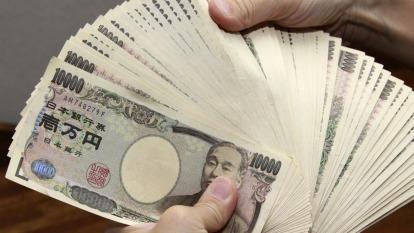 避險情緒升溫 投機者加碼看多日圓、美元(圖片:AFP)