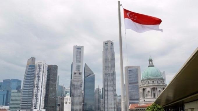 新加坡下調經濟成長展望 貿易戰影響波及整個亞洲 (圖片:AFP)