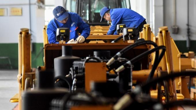 景氣趨緩縮減產能,無薪假增至2012人創今年新高。(圖:AFP)