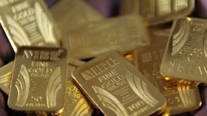 隨著投資者尋求避險 流入ETF的黃金達到千噸 (圖片:AFP)