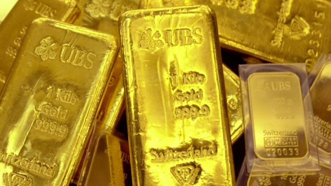 避險潮再起 金價創三週來最大回彈(圖片:AFP)