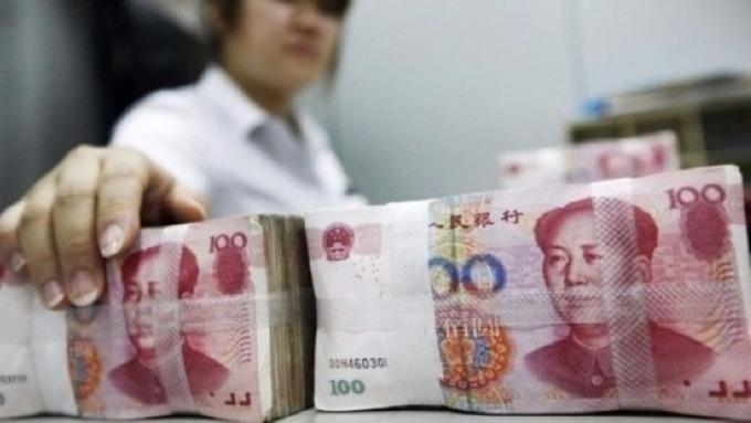 離岸、在岸人民幣不甩中間價「連續單邊貶值」 圖片:AFP