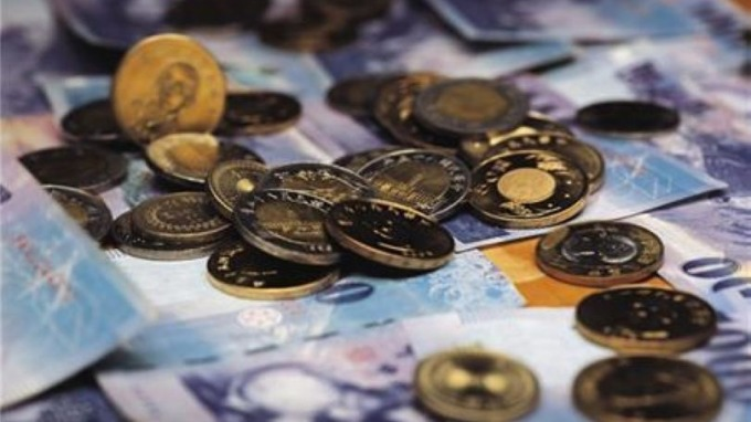 大摩:預期台灣壽險業將增加遠匯避險有助穩台幣 (圖: AFP)