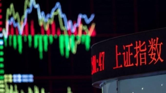 外資增持A股湧現小高潮 陸股通本周淨買入邁向逾半年來最大 (圖片:AFP)