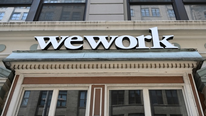 商業前景受質疑 Wework擬推遲IPO、調降估值至200億美元 (圖:AFP)