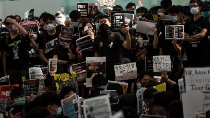 彭博專欄:久不平息的香港亂局 令中國不願祭出「上兆」刺激 (圖片:AFP)