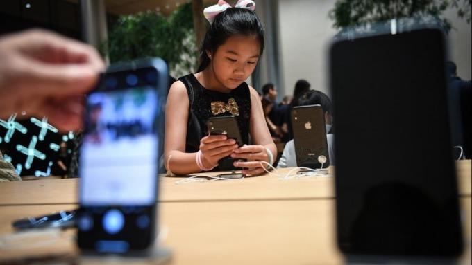 IDC:智慧手機下半年起復甦 明年5G手機估占出貨量8.9%(圖片:AFP)