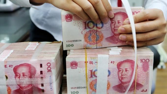 中國擁抱數位貨幣浪潮 人民銀行版「正規軍」正加速駛來(圖片:AFP)