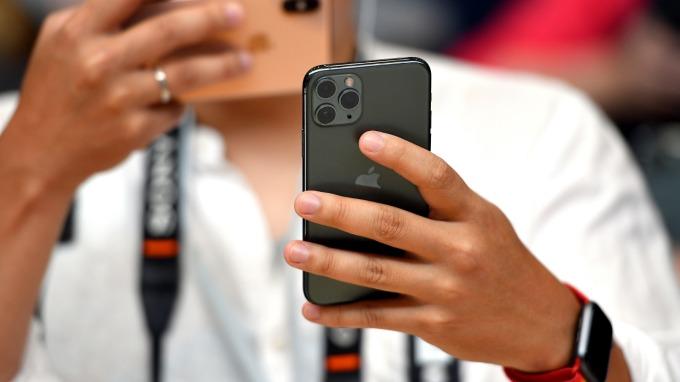 無支援5G!iPhone 11恐錯失中國市場換機潮?(圖:AFP)