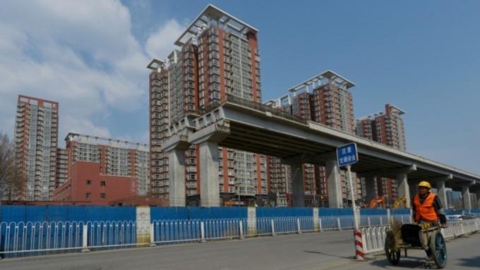 房市漲幅趨緩 中國半數以上城市持有房產面臨虧損   (圖:AFP)
