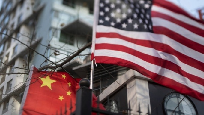 陸商務部:中美雙方工作層將近期見面 已就美豆、美豬開始詢價 (圖片:AFP)