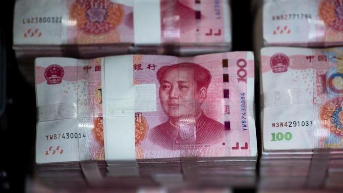 人民幣「國際化」之路裹足不前 三年努力僅換得0.3%增長 (圖片: AFP)