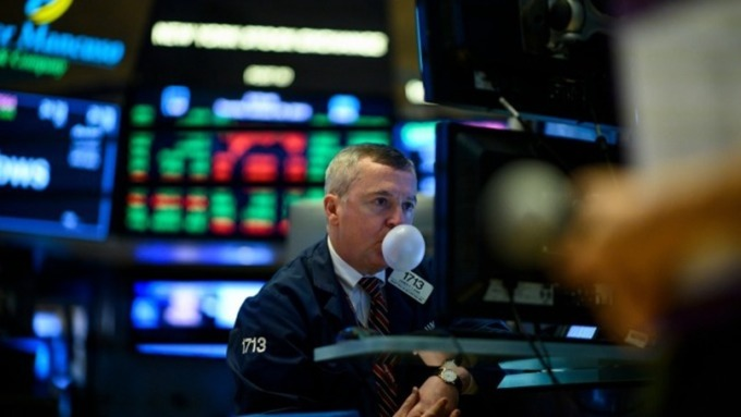 市場靜待Fed決議 美股4大指數小幅開低 (圖片:AFP)