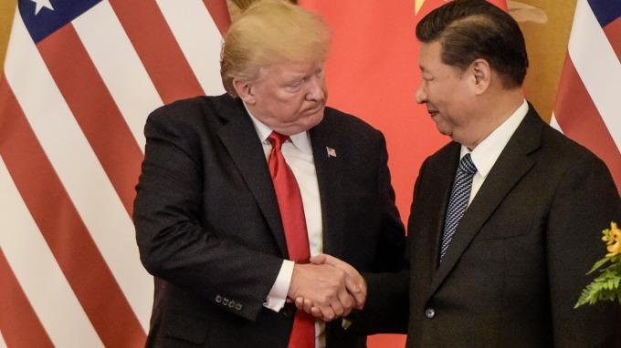 川普贏了中美戰第一回合 但第二回合中國佔了上風 (圖片:AFP)