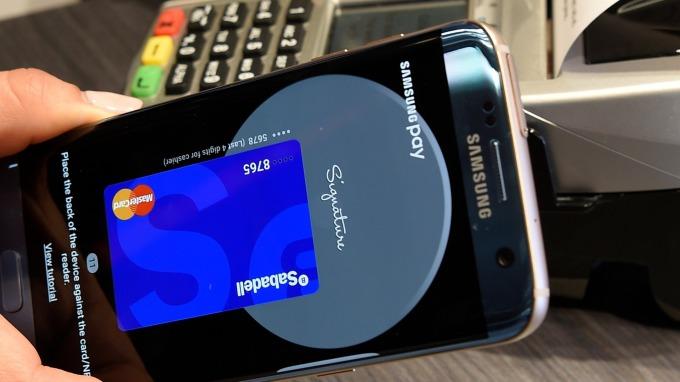 三星Samsung Pay推出跨境轉帳、金融預付卡(圖片:AFP)