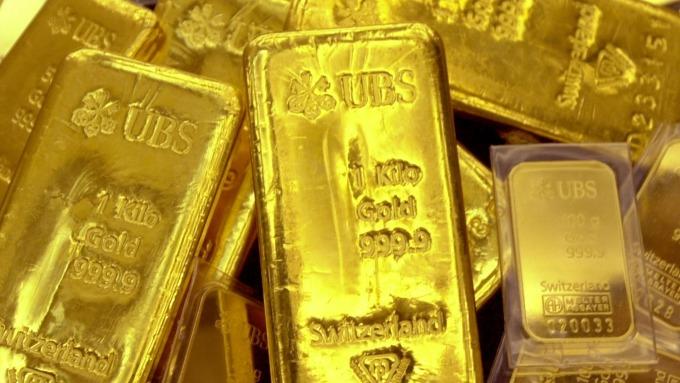 貴金屬盤後-Fed擴大資產負債表 市場靜候美中談判發展 黃金收高(圖片:AFP)