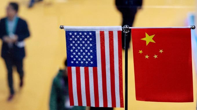 美中達成初步貿協 這些股為最大贏家(圖片:AFP)