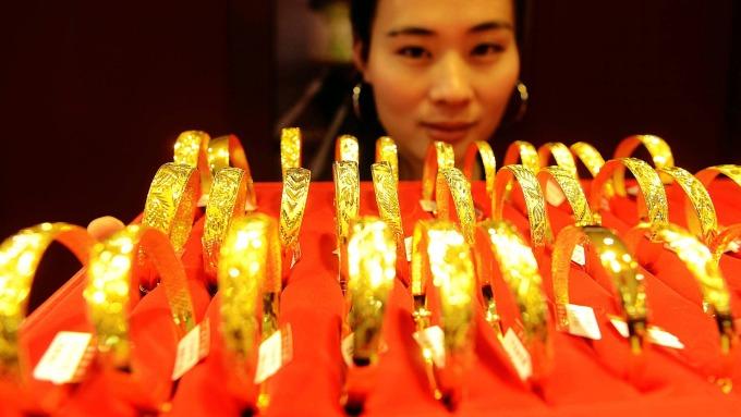 經濟放緩及價格提高 造成中國黃金需求下滑(圖片:AFP)