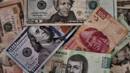 降息潮方興未艾 專家警告:沉迷廉價貨幣恐對全球造成巨大傷害  (圖片:AFP)