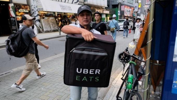 美食外送平台蔚為風潮,外送員保障如何兼顧成為市場熱議話題。(圖:AFP)