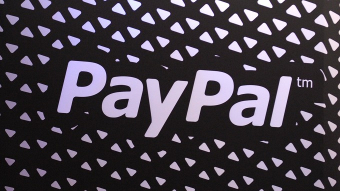 PayPal優化一鍵轉帳 擴增合作商家 穩坐行動支付寶座 (圖片:AFP)