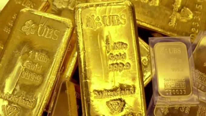 貴金屬盤後-中國GDP萎靡 市場靜待脫歐結果 黃金回收本週漲幅(圖片:AFP)
