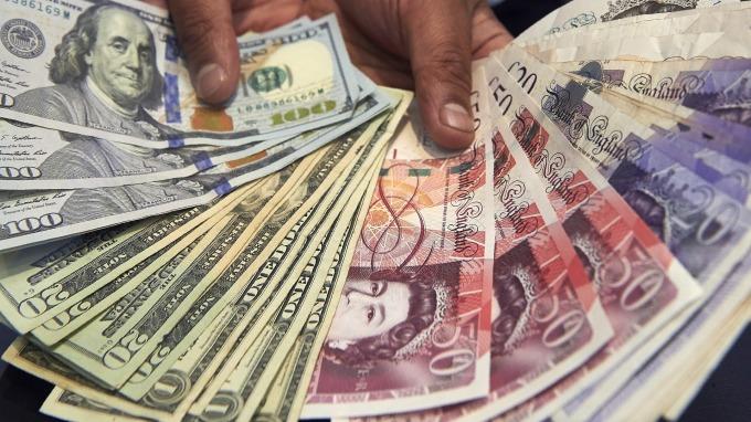 高盛:英國無協議脫歐機率降至5% 英鎊有望升至1.35美元 (圖片:AFP)