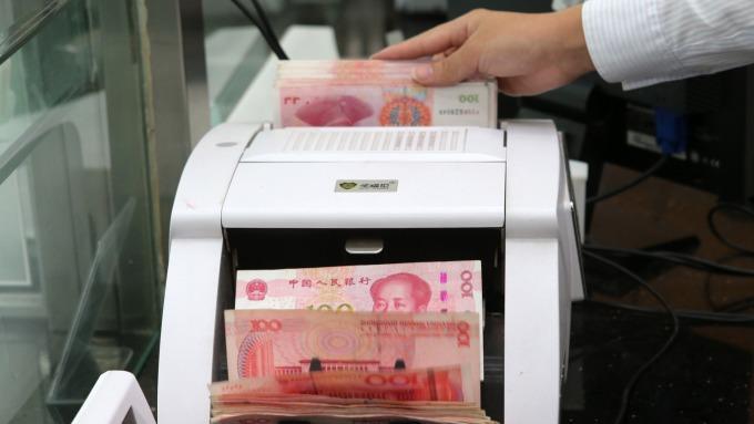 美中談判雖有進展 野村看人民幣升破7.0仍困難重重  (圖片:AFP)