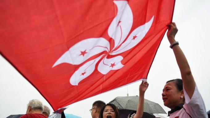 貿易戰與社運衝擊 香港人消費信心低落(圖片:AFP)