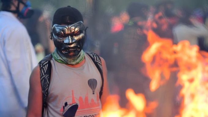 智利動亂的背後  (圖片:AFP)