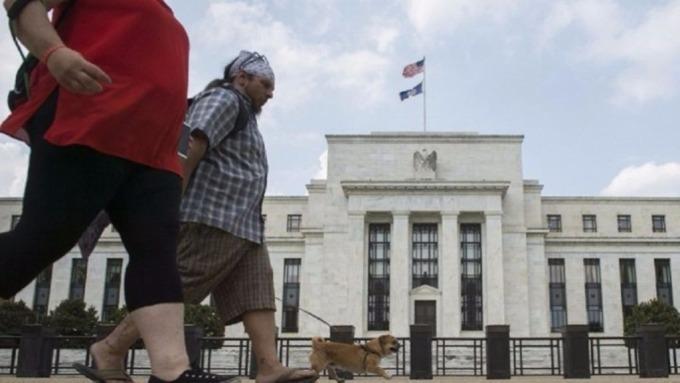 聯準會降息一碼,激勵股票型基金獲資金挹注。(圖:AFP)