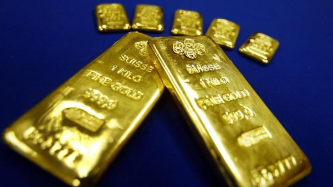 貴金屬盤後—不利因素緩和 黃金回升 但未突破1500美元(圖片:AFP)
