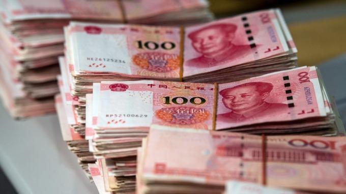 留意人民幣及A股盤中之走勢。(圖/AFP)