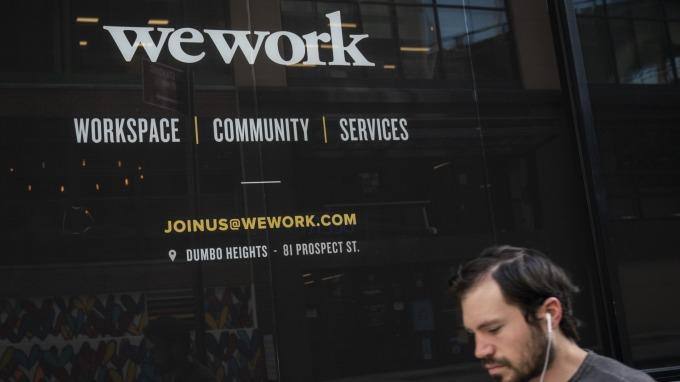 WeWork 四面楚歌 全球大裁員 2400 人。(圖片:AFP)